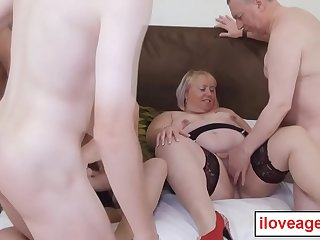A group of old men and women having an orgy