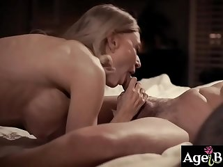 Nina Hartley entrapping Justin Hunt in her sensual gaze making him get hooked