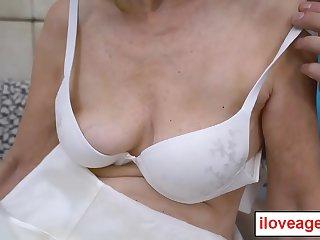 70 year old granny Suzana sucks and fucks a youthful cock