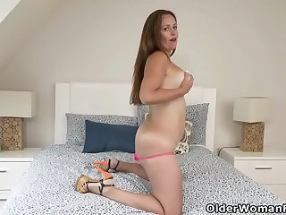 Canadian milf Brandii fingers her pussy in pink lingerie