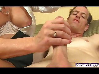 Busty cougar jerking dick and licking balls