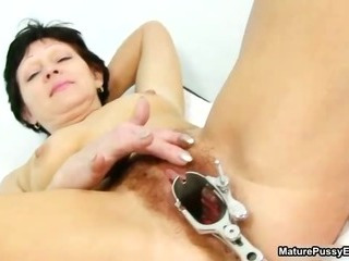 Hairy mature mom spreads wide and gets