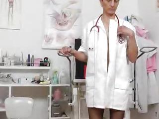 Nasty head nurse Rozi fingers her amazing piss hole