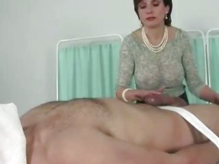 Domina rubbs one out for her slave